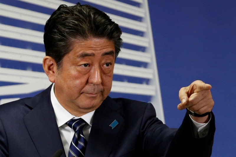 Japan's Prime Minister Shinzo Abe, who is also leader of the Liberal Democratic Party, attends a news conference in Tokyo
