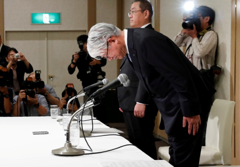 Kobe Steel President and CEO Hiroya Kawasaki bows during a news conference in Tokyo