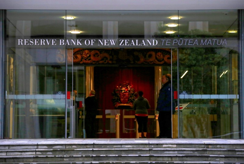 FILE PHOTO: A security guard stands in the main entrance to the Reserve Bank of New Zealand located in central Wellington, New Zealand