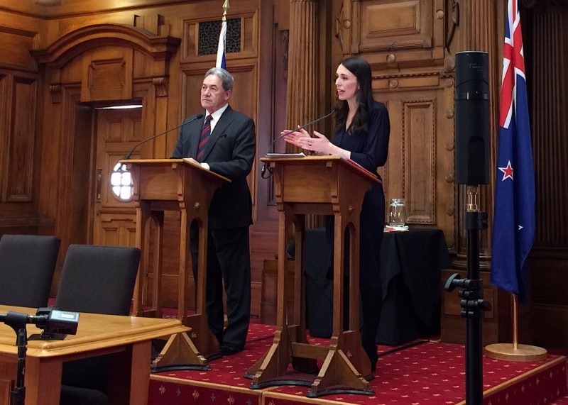 New Zealand's Prime Minister-designate Jacinda Ardern speaks as she stands next to New Zealand First party leader Winston Peters after their meeting in Wellington