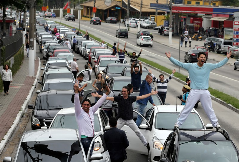 Uber drivers protest against legislation threatening the company's business model in Sao Paulo