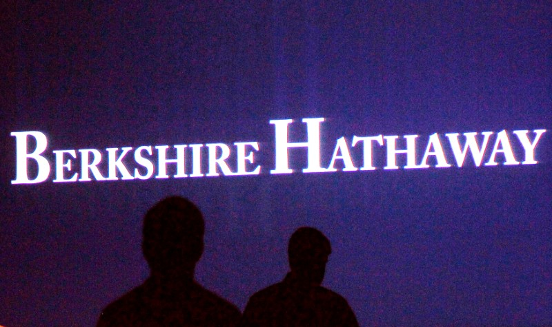 FILE PHOTO - Berkshire Hathaway shareholders walking by a video screen at the company's annual meeting in Omaha