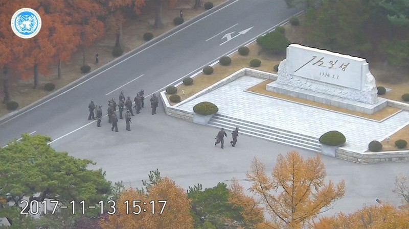 Still image from video shows North Korean soldiers holding rifles and gathering in the North Korean side of the Joint Security Area at the Demilitarized Zone between North and South Korea
