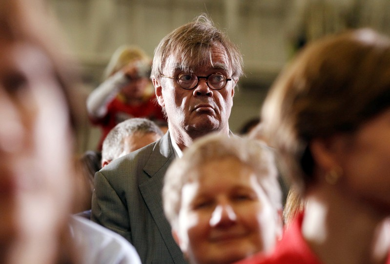 FILE PHOTO: Author and radio personality, Keillor, listens to U.S. President Barack Obama speak at a campaign rally in Minneapolis