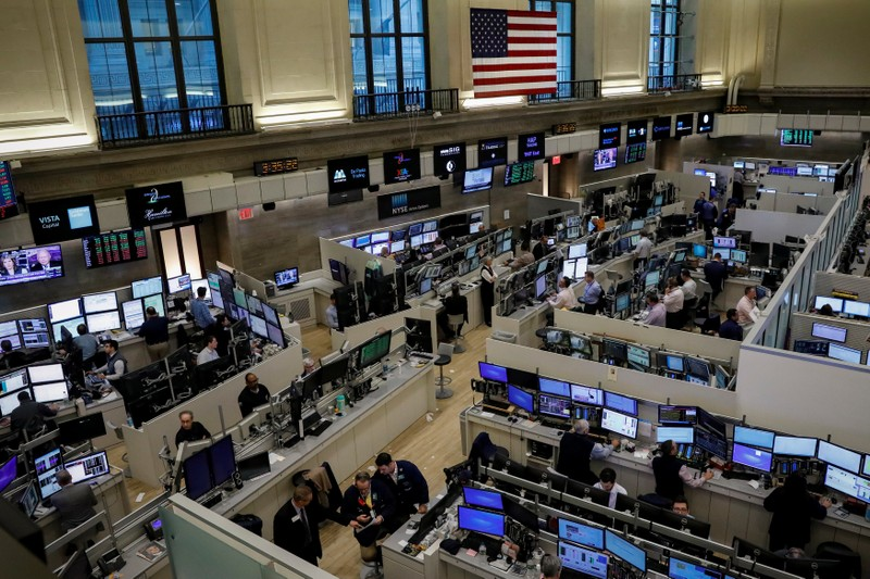 Traders work on the floor of the American Stock Exchange (AMEX) at the NYSE in New York