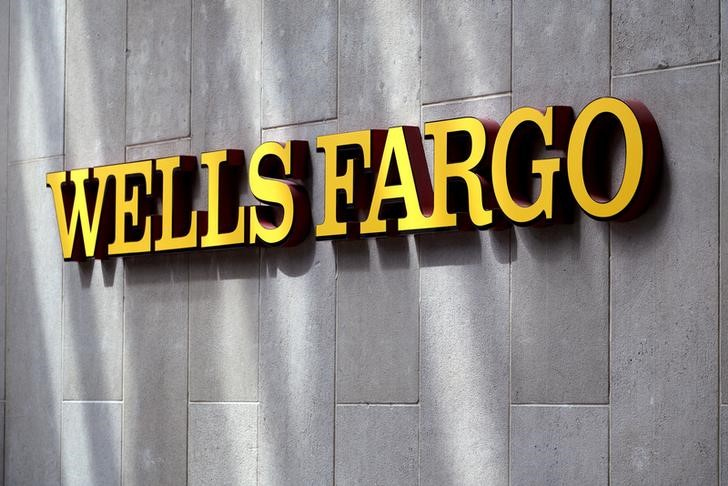 FILE PHOTO - The sign outside the Wells Fargo & Co. bank in downtown Denver