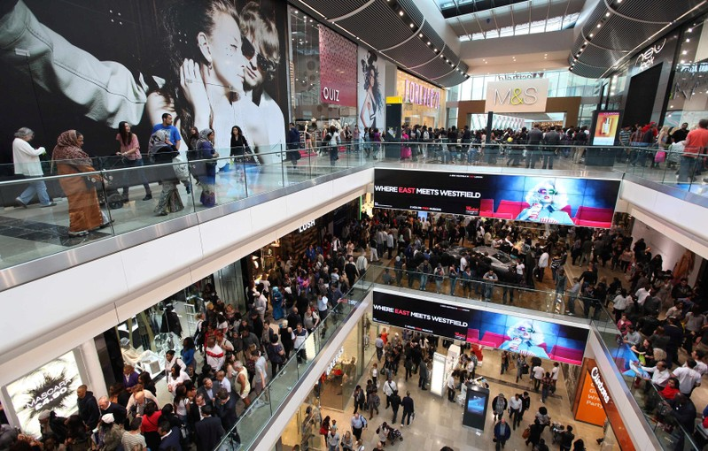 FILE PHOTO: Shoppers crowd the walkways on opening day of the Westfield Stratford City in east London