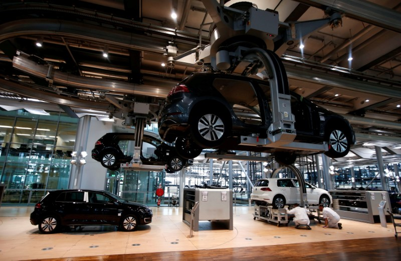 FILE PHOTO: Workers assemble a VW e-Golf electric car in Dresden