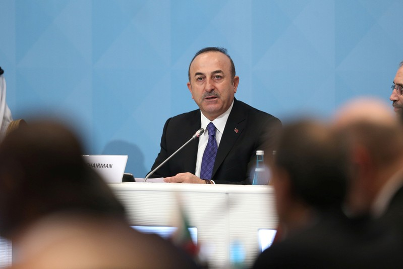 Turkish Foreign Minister Cavusoglu speaks during a meeting of theOIC Foreign Ministers Council in Istanbul