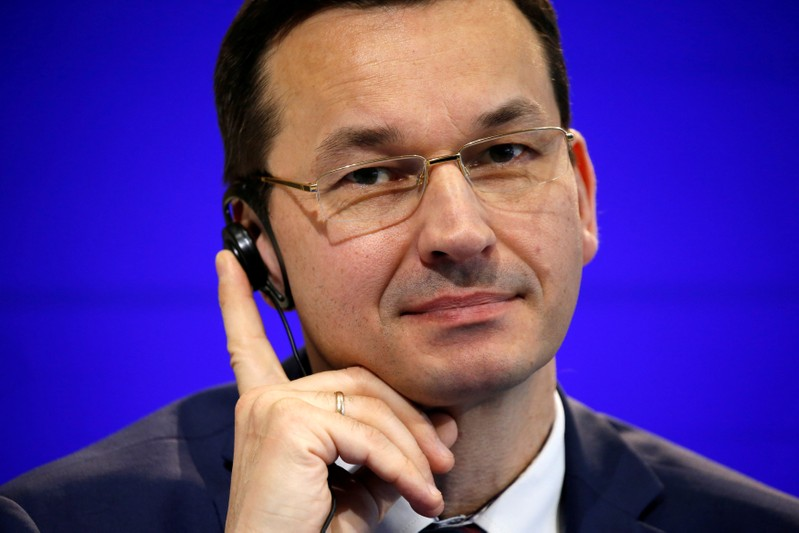 FILE PHOTO: Poland's Deputy Prime Minister and Finance Minister Mateusz Morawiecki attends a news conference at the Bercy Ministry in Paris