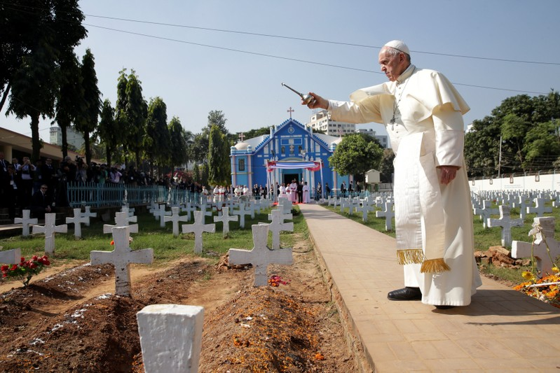 Pope Francis walks through the cemetery at the Church of the Holy Rosary in Dhaka