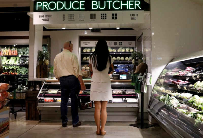 FILE PHOTO: Customers shop at a Whole Foods store in New York