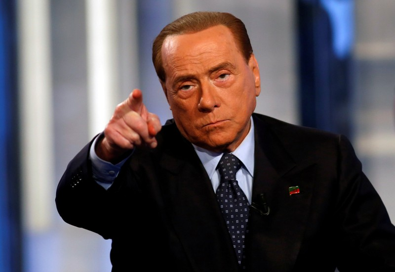 FILE PHOTO: Italy's former Prime Minister Silvio Berlusconi gestures as he attends television talk show