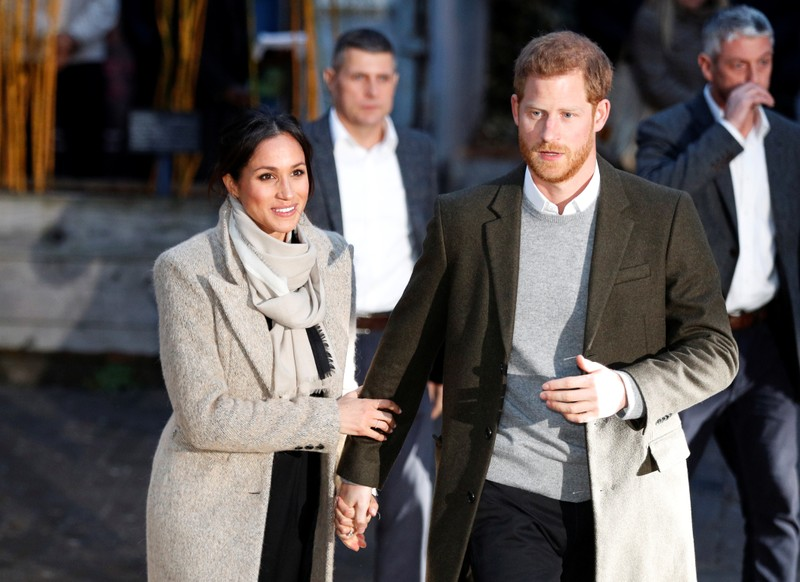 Britain's Prince Harry and his fiancee Meghan Markle leave after visiting radio station Reprezent FM, in Brixton, London