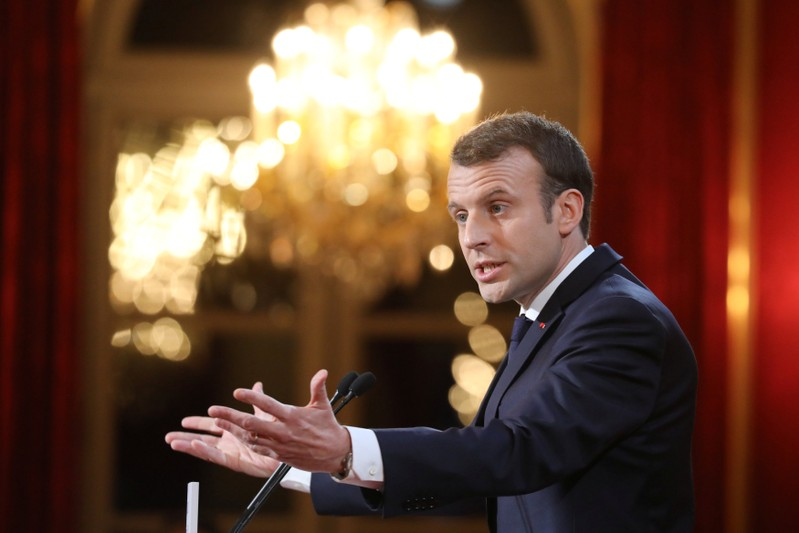 French President Emmanuel Macron delivers his New Year wishes to the members of the press corps at the Elysee Palace in Paris