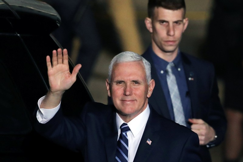 U.S. Vice President Mike Pence waves upon their arrival at Ben Gurion international Airport in Lod, near Tel Aviv, Israel