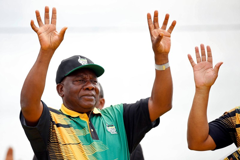 President of the ANC Cyril Ramaphosa waves to supporters ahead of the ANC's 106th anniversary celebrations, in East London