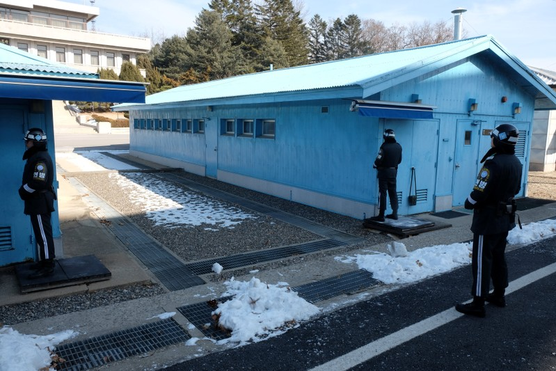 South Korean soldiers stand guard in the demilitarized zone separating the two Koreas, in the truce village of Panmunjom