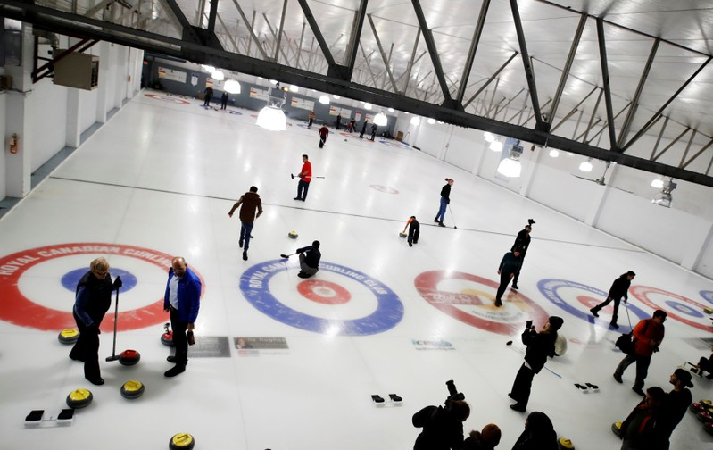 FILE PHOTO: Refugees learn the sport of curling at the Royal Canadian Curling Club during an event put on by the