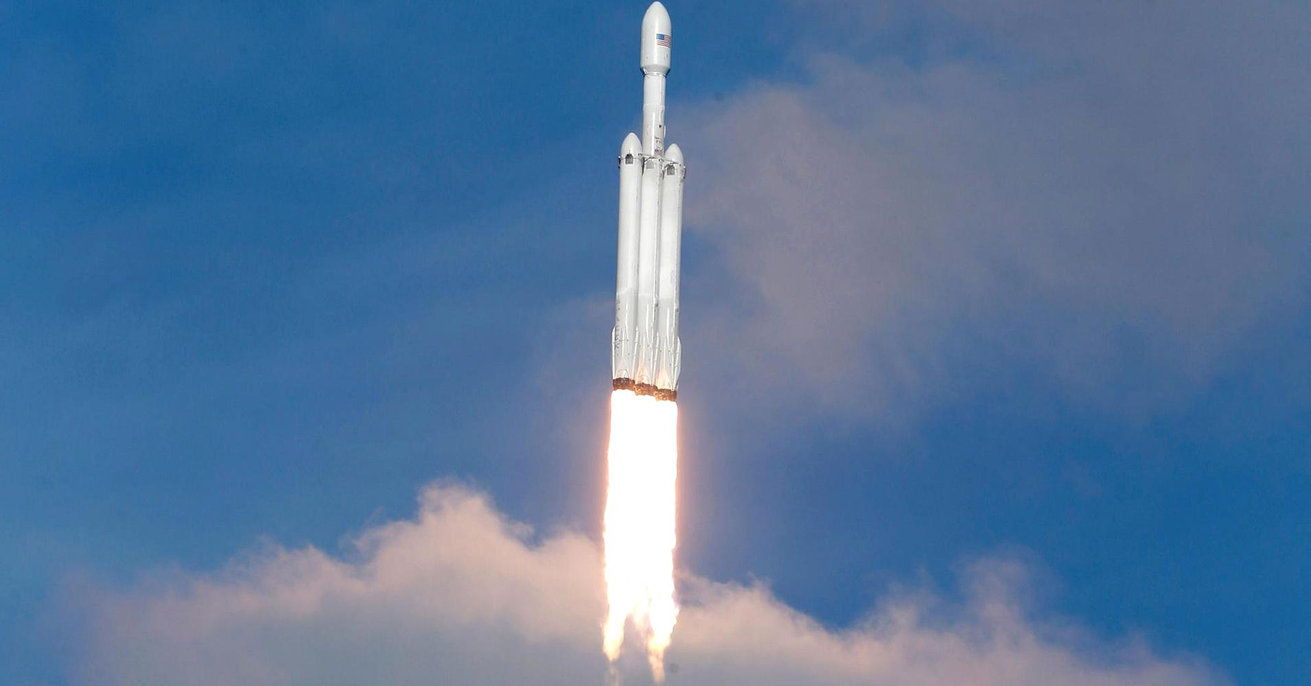 Elon Musk wants 'a new space race,' says new SpaceX rocket ...