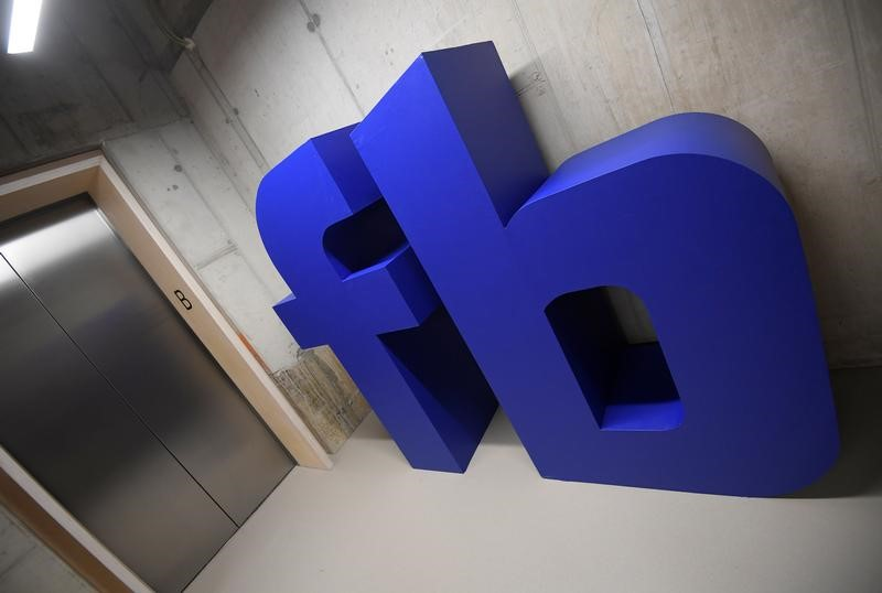FILE PHOTO: A giant logo is seen at Facebook's headquarters in London