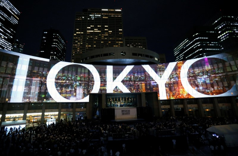 Images, using projection-mapping technology, are beamed on a building of Tokyo Metropolitan Government Office during a countdown event to mark three years until the Tokyo 2020 Summer Olympics in Tokyo