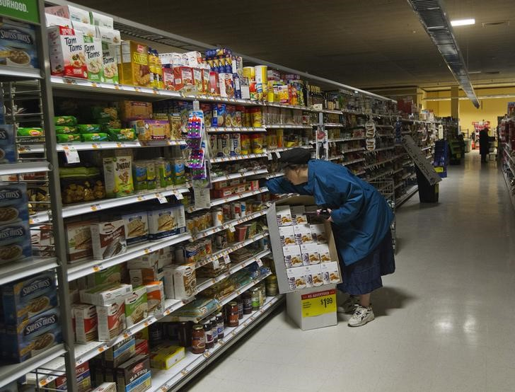 A woman looks for supplies at a Waldbaums grocery store in Long Beach, New York