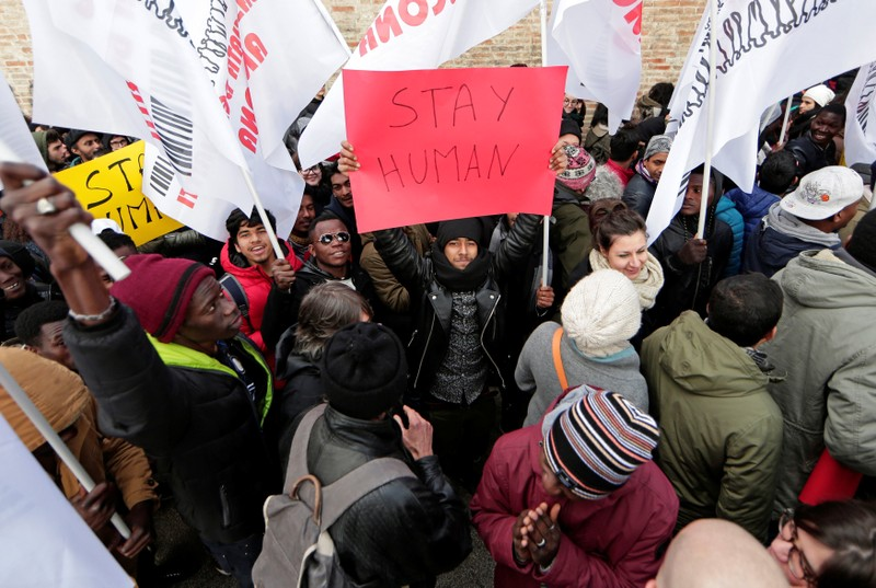 Demonstrators march during an anti-racism rally in Macerata