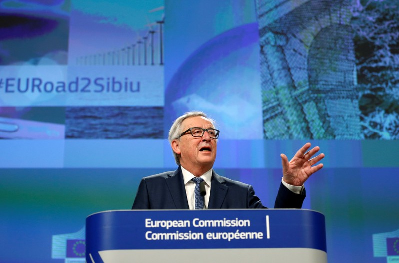 EU Commission President Juncker addresses a news conference in Brussels