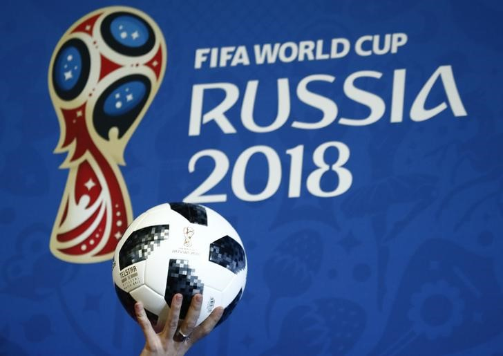 FILE PHOTO: A presenter holds the official match ball for the 2018 FIFA World Cup Russia during an event to announce the new 2018 FIFA Fan Fest Ambassadors in Moscow