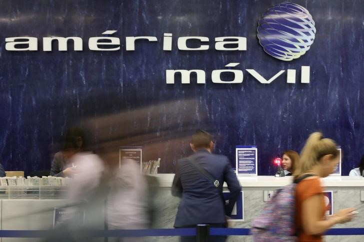 The logo of America Movil is pictured on the wall of a reception area in the company's corporate offices in Mexico City