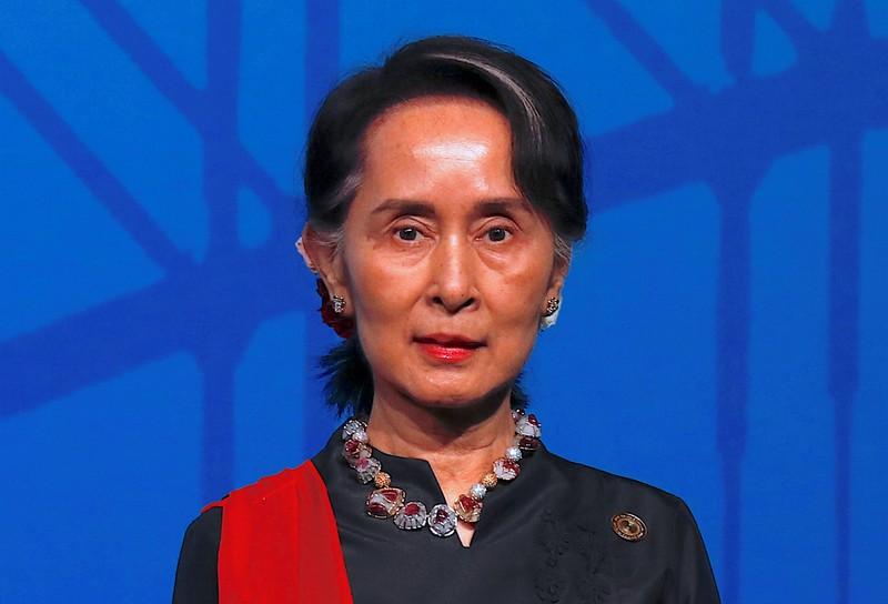 Myanmar's State Counsellor Aung San Suu Kyi stands during the Leaders Welcome and Family Photo at the one-off ASEAN summit in Sydney
