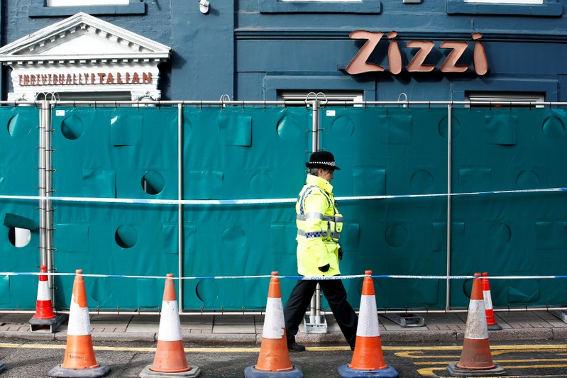 A police officer stands on duty outside a restaurant which has been secured as part of the investigation into the poisoning of former Russian inteligence agent Sergei Skripal and his daughter Yulia, in Salisbury