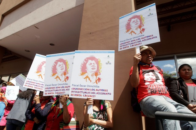 Lenca indigenous hold placards during a protest to mark the second anniversary of the killing of environmental activist Berta Caceres, in Tegucigalpa