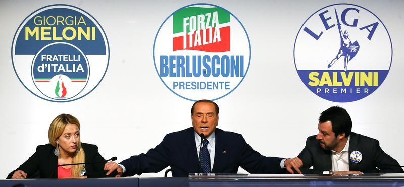Forza Italia leader Silvio Berlusconi speaks flanked by Fratelli D'Italia party leader Giorgia Meloni and Northern League leader Matteo Salvini during a meeting in Rome