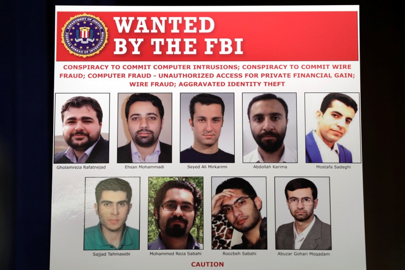 Pictures of nine Iranians charged with conducting massive cyber theft campaign are on display