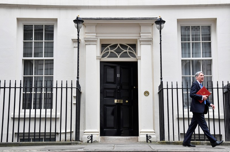 Britain's Chancellor of the Exchequer Philip Hammond leaves 11 Downing Street to deliver his half-yearly update on the public finances, in London