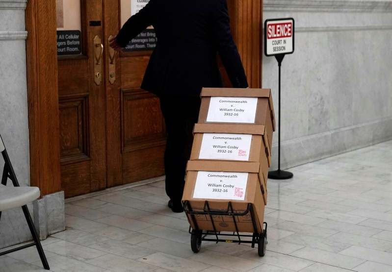 Boxes of evidence are brought to the court room for actor and comedian Bill Cosby's sexual assault retrial at the Montgomery County Courthouse in Norristown, Pennsylvania