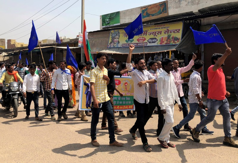 People belonging to the Dalit community shout slogans as they take part in a nationwide strike called by several Dalit organisations, in Kasba Bonli
