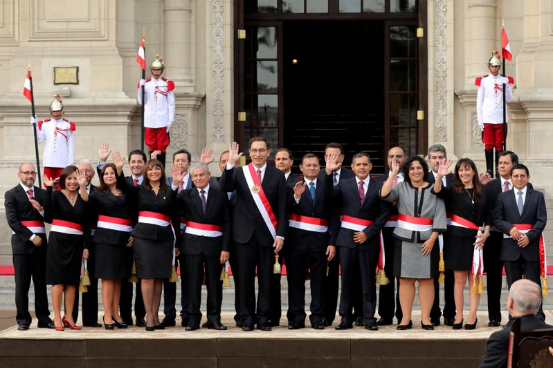 Peru's President Martin Vizcarra and new ministers pose for a picture during the swearing-in ceremony at the government palace in Lima, Peru