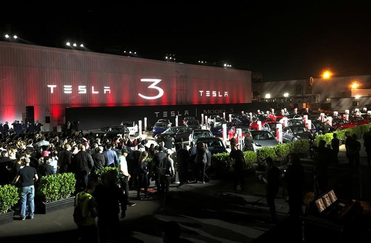 FILE PHOTO: Tesla introduces Model 3 cars off the Fremont factory's production line during an event at the company's facilities in Fremont