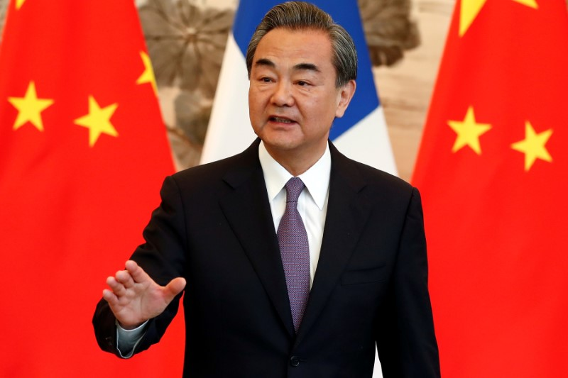 FILE PHOTO - China's State Councilor and Foreign Minister Wang Yi gestures during a signing ceremony in Beijing, China