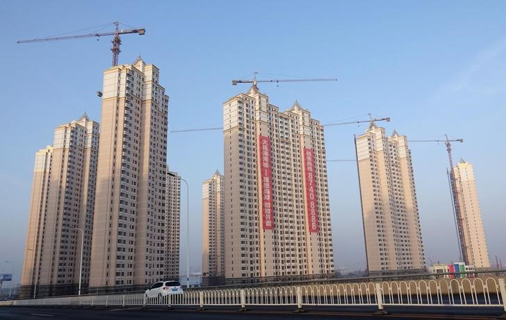 FILE PHOTO - Residential buildings under construction are seen in Jinpu New District in Dalian, Liaoning