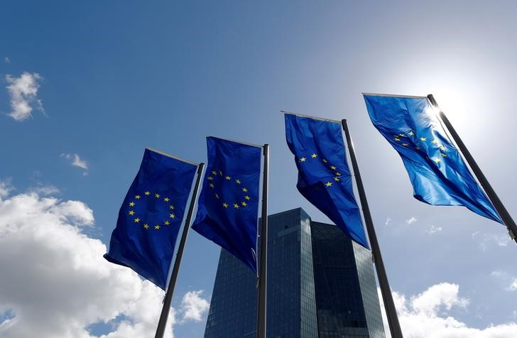 FILE PHOTO: European Union flags flutter outside the European Central Bank (ECB) headquarters in Frankfurt