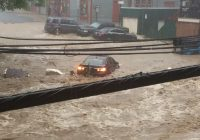 Flash floods turn Maryland town's Main Street into raging muddy river