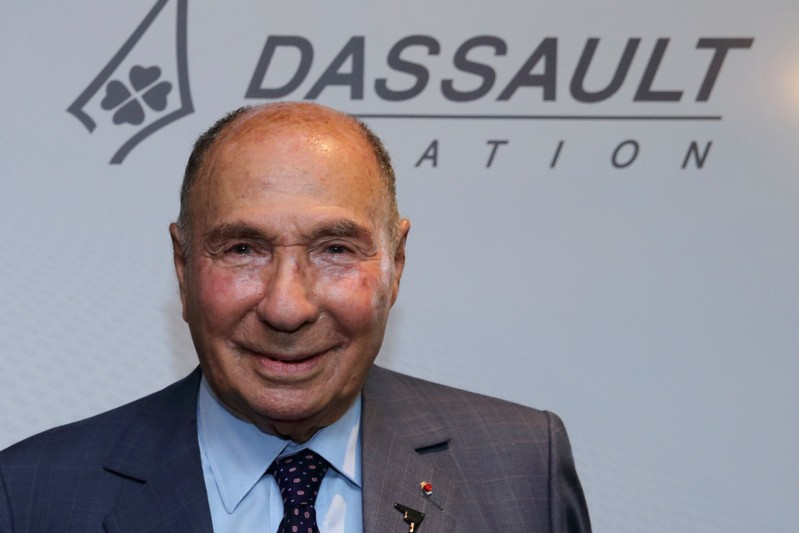 FILE PHOTO: Serge Dassault, French UMP political party member and CEO of Groupe Dassault Holding, poses after the company's 2014 First-Half results presentation in Saint Cloud near Paris