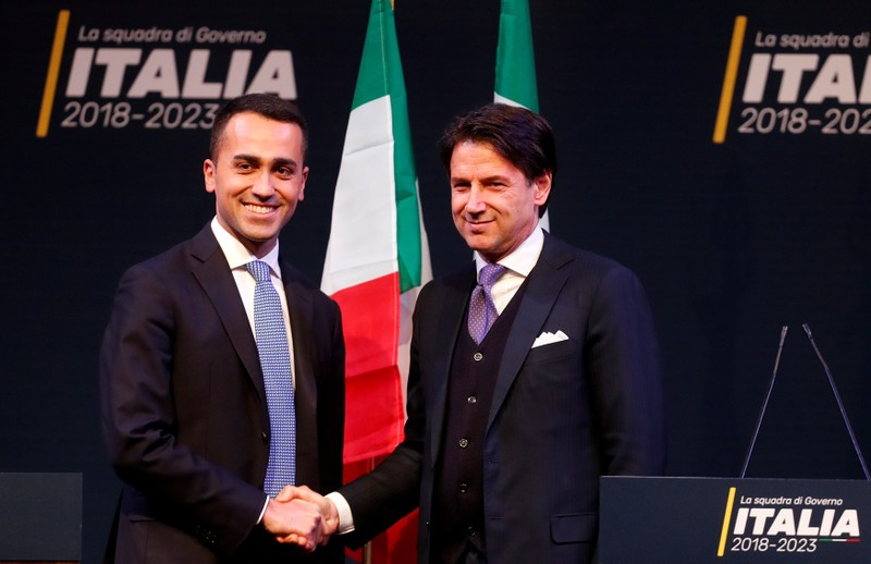 FILE PHOTO: 5-Star Movement leader Di Maio shakes hands with Giuseppe Conte in Rome ahead of Italy's election