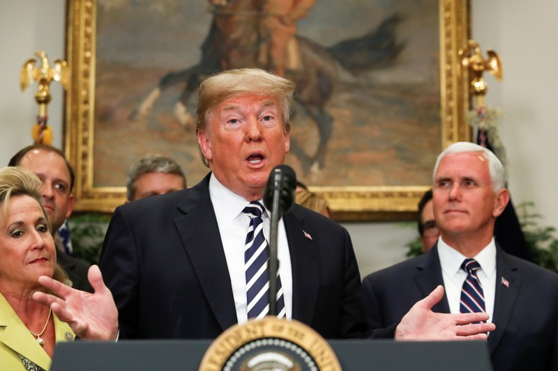 U.S. President Donald Trump gestures as he speaks before the signing ceremony for S. 2155 - Economic Growth, Regulatory Relief, and Consumer Protection Act in the Roosevelt Room at the White House in Washington