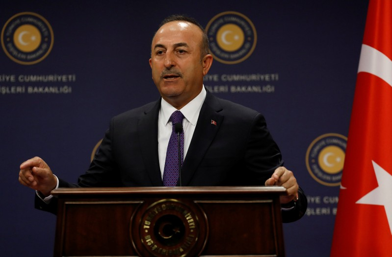 Turkish Foreign Minister Mevlut Cavusoglu gestures during a news conference in Ankara