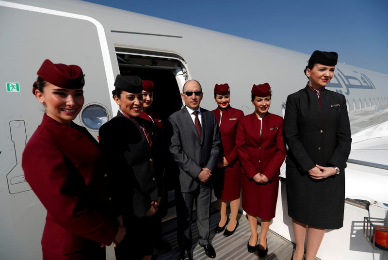 FILE PHOTO: Qatar Airways Chief Executive Officer Akbar al-Baker poses with cabin crew in an Airbus A350-1000 at the Eurasia Airshow in the Mediterranean resort city of Antalya